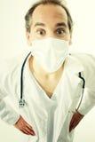 Doctor con el estetoscopio y la máscara médica Foto de archivo