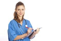 Doctor con el sujetapapeles Imagenes de archivo