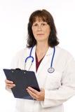 Doctor con el tablero aislado en blanco Fotos de archivo libres de regalías