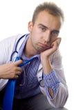 Doctor con exceso de trabajo Fotos de archivo