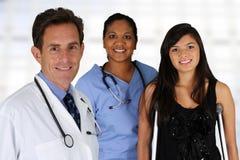 Doctor con la enfermera y el paciente Fotografía de archivo libre de regalías