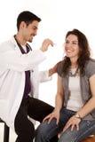 Doctor con la luz y el paciente Fotos de archivo