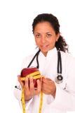 Doctor con la manzana roja Fotografía de archivo libre de regalías