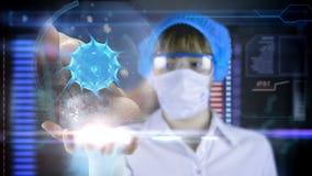 Doctor con la tableta futurista de la pantalla del hud Bacterias, virus, microbio almacen de video