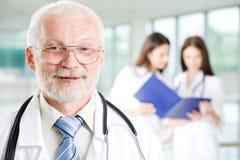 Doctor con las enfermeras Fotografía de archivo