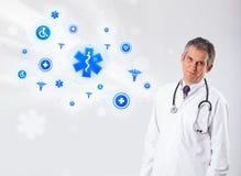 Doctor con los iconos médicos azules Imágenes de archivo libres de regalías