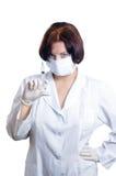 Doctor con una jeringuilla fotografía de archivo