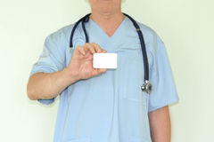 Doctor concept medicine. Card in hand royalty free stock photography