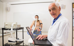 Doctor conducting fitness test smiling at camera Stock Photos