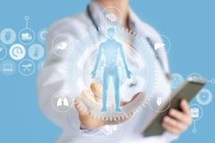 Doctor conducts a study on virtual screen. stock photos