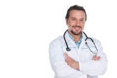 Doctor confiado sonriente que mira la cámara. Imagen de archivo libre de regalías