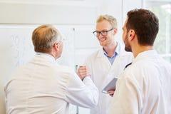 Doctor congratulating colleague. For successful teamwork stock photo