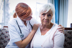 Doctor consoling senior woman Royalty Free Stock Photo