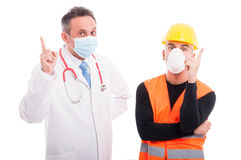Doctor and constructor showing idea gesture index finger Stock Photography