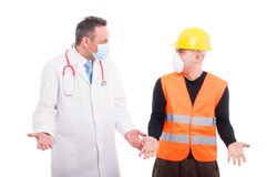 Doctor and constructor standing making questioning gesture Royalty Free Stock Photo
