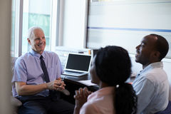 Doctor In Consultation With Couple In Office royalty free stock photos