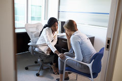 Doctor In Consultation With Depressed Female Patient stock photos