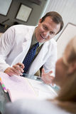 Doctor in consultation with female patient Stock Images