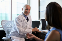 Doctor In Consultation With Female Patient In Office Royalty Free Stock Photos