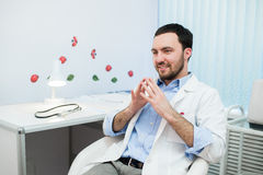 Doctor in consultation with patient sitting in front of him.  Stock Image