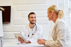Doctor in consultation with patient. That trusts him royalty free stock photography