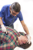 Doctor consulting injured worker Stock Image