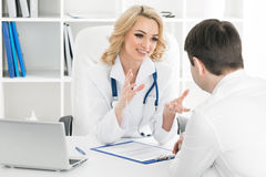 Doctor consulting patient. In a clinical office Royalty Free Stock Photos