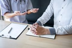 Doctor consulting with patient examining for patient, presenting results symptom about the problem and recommend treatment method. Healthcare and medical royalty free stock images