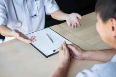 Doctor consulting with patient examining for patient, presenting results symptom about the problem and recommend treatment method royalty free stock photos