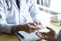 Doctor consulting with patient examining for using medicine, presenting results symptom about the problem and recommend treatment. Method, Healthcare and stock photo