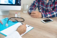 Doctor consulting patient hands closeup. Patient sitting at doct. Or office. Diagnostic, prevention of women diseases, healthcare,1 Stock Images