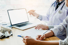 Doctor consulting with patient presenting results on blank Scree stock images