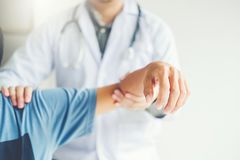 Doctor consulting with patient Shoulder problems Physical therapy diagnosing concept.  stock image