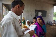 Doctor consulting a patrient medical note in India Stock Image