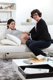 Doctor consulting with pregnant woman Royalty Free Stock Image