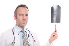 Doctor consulting an x-ray of a knee joint. Doctor or orthopaedic specialist consulting an x-ray of a knee joint pointing with his pen and turning his head to stock images