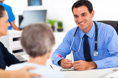 Doctor consulting senior Royalty Free Stock Photo