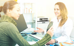 Doctor consulting visitor female in aesthetic medicine center Stock Photography