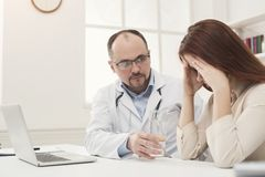 Doctor consulting woman in hospital stock photos