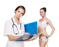 Doctor consults young woman Stock Photography