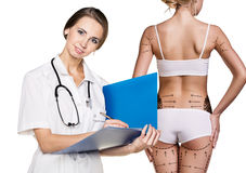 Doctor consults young woman. Doctor consults young women about diet on the white background Royalty Free Stock Image