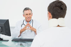 Doctor in conversation with patient at office Stock Image