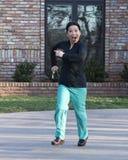 Doctor coreano que corre abajo de su calzada Imágenes de archivo libres de regalías