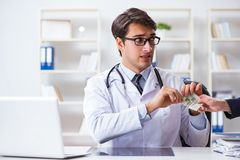 The doctor in corruption concept with being offered bribe. Doctor in corruption concept with being offered bribe Stock Image