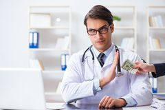 The doctor in corruption concept with being offered bribe. Doctor in corruption concept with being offered bribe Stock Photography