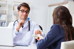 The doctor in corruption concept with being offered bribe. Doctor in corruption concept with being offered bribe Stock Photos