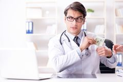 The doctor in corruption concept with being offered bribe. Doctor in corruption concept with being offered bribe Royalty Free Stock Images