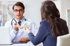 The doctor in corruption concept with being offered bribe. Doctor in corruption concept with being offered bribe Royalty Free Stock Photo