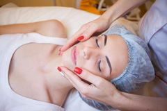 Doctor cosmetologist doing facial massage girl spa Royalty Free Stock Image