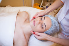 Doctor cosmetologist doing facial massage girl spa Stock Image